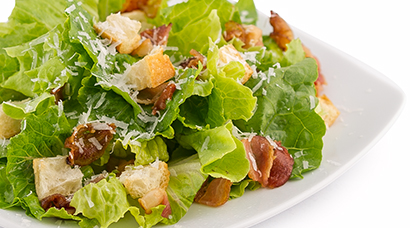 Bed of green oak & romaine lettuce, smoked bacon, homemade mini croutons, shaved parmesan cheese. Large size comes with 2 oven baked garlic knots. (Garlic knots subject to availability. Sometimes we are sold out. Price remains the same regardless.)