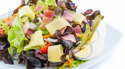 Bed of red & green oak lettuce, diced ham, roasted bacon bits, shredded cheese, hardboiled egg, sliced tomato, diced onion, shredded carrot, diced cornichon pickle. Includes side of bread and house-made Italian style vinaigrette.